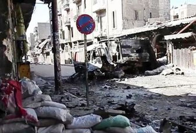 Main_410px-bombed_out_vehicles_aleppo